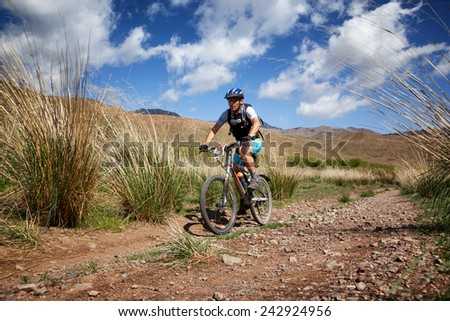 "ALMATY, KAZAKSTAN - MAY 01, 2011: O.Jukov (N38) in action at Adventure mountain bike cross-country marathon in mountains ""Jeyran Trophy 2011""  - stock photo"