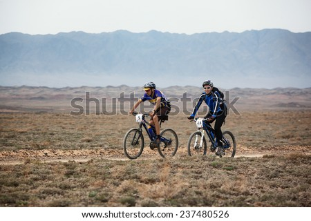 "ALMATY, KAZAKSTAN - MAY 01, 2009: P.Krasovetsky (N5) and A.Kaspersky (N23) in action at Adventure mountain bike cross-country marathon in mountains ""Jeyran Trophy 2009""  - stock photo"