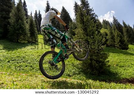 ALMATY, KAZAKSTAN - MAY 26: V.Merkuryev (N49) in action at Freestyle Bike Session in Almaty, Kazakstan MAY 26, 2012. - stock photo