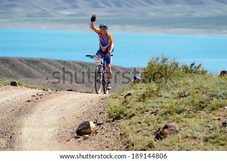 "ALMATY REGION, KAZAKHSTAN - MAY 7, 2013: E.Kazantcev(N7) in action at Adventure mountain bike cross-country marathon in mountains ""Jeyran Trophy 2013"".  - stock photo"
