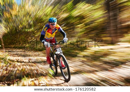"ALMATY REGION, KAZAKHSTAN - OCTOBER 13: E.Kazantcev (N163) in action at mountain bike sports event ""Red Bull Mountain Rage"" October 13, 2013 in Almaty region, Kazakhstan.  - stock photo"