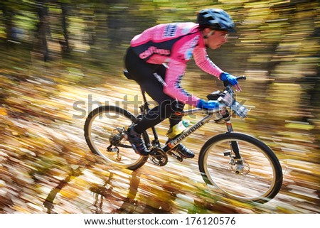 "ALMATY REGION, KAZAKHSTAN - OCTOBER 13: I.Popov (N192) in action at mountain bike sports event ""Red Bull Mountain Rage"" October 13, 2013 in Almaty region, Kazakhstan.  - stock photo"