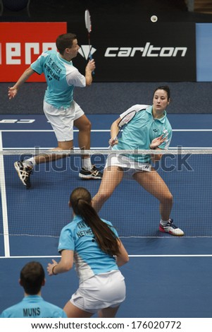 ALMERE - FEBRUARY 1: Jorrit de Ruiter (left) and Samantha Barning (right) reach the semi finals in the National Championships badminton 2014 in Almere, The Netherlands on February 1, 2014. - stock photo