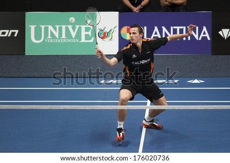 ALMERE - FEBRUARY 2: Mark Caljouw loses his match in the semi finals in the National Championships badminton 2014 in Almere, The Netherlands on February 2, 2014. - stock photo