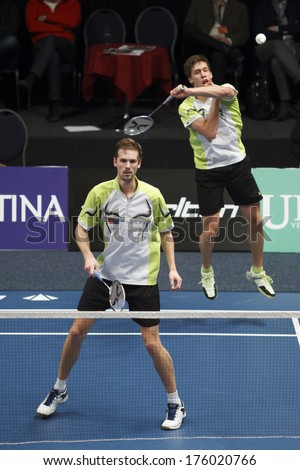 ALMERE - FEBRUARY 2: Ruud Bosch (left) and Koen Ridder (right) reach the final in the National Championships badminton 2014 in Almere, The Netherlands on February 2, 2014. - stock photo
