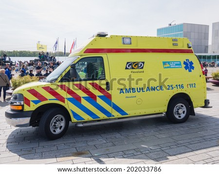 ALMERE, NETHERLANDS - 12 APRIL 2014: Ambulance on the scene during an enacted emergency scene at the first National Security Day held in the city of Almere - stock photo