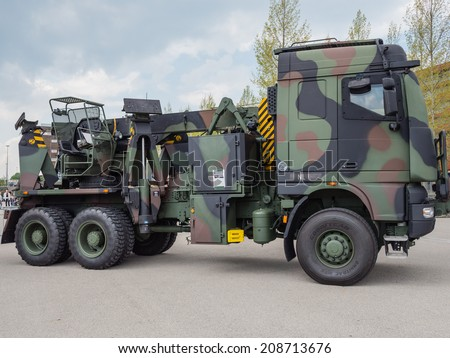 ALMERE, NETHERLANDS - 23 APRIL 2014: Dutch military tow truck on display during the National Army Day in Almere can be inspected by the general public at close range - stock photo