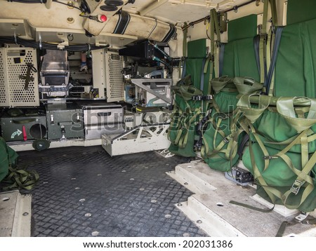 ALMERE, NETHERLANDS - 12 APRIL 2014: Look inside the rear of a military vehicle on display during the first National Security Day held in the city of Almere - stock photo