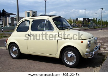 Almere Poort, Flevoland, The Netherlands - August11, 2014: Beige Fiat 500 parked in a public parking lot in Almere. - stock photo