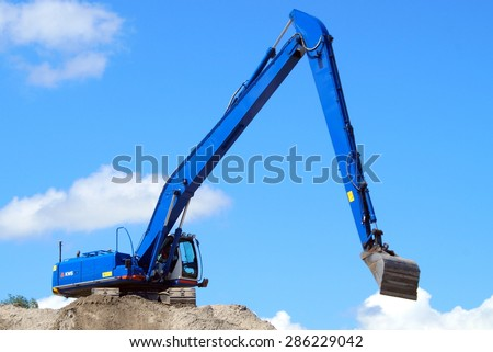 Almere Stad, Flevoland, The Netherlands - June 8, 2015: Hitachi 470 Longreach KWS Crawler Excavator working at a sandy Dutch construction site in the fastest growing city of the Netherlands: Almere - stock photo
