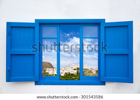 Almeria view from blue window of Mojacar photo mount - stock photo