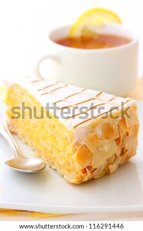 almond cake and cup of tea - stock photo