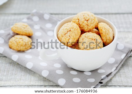 almond cookies, a cup of white amarettini, food closeup