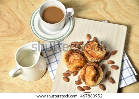 Almond Danish Cup Cakes with coffee on wooden table,Bakery Background.