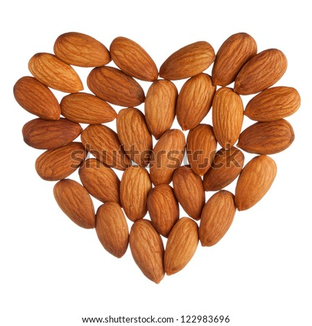 Almond heart isolated on white background - stock photo