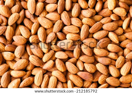 almond nuts on the table as a background.