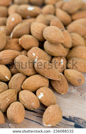 almond nuts on wooden surface - stock photo
