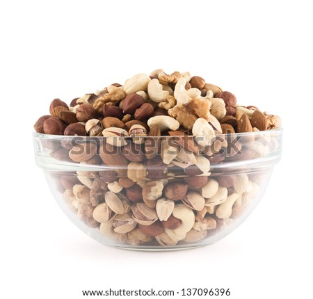 Almond, pistachio, peanut, walnut, hazelnut mixed in a glass bowl isolated over white background - stock photo