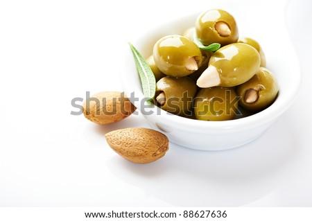 Almond stuffed olives isolated on white background - stock photo