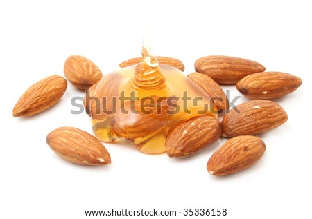almond with honey isolated on white - stock photo