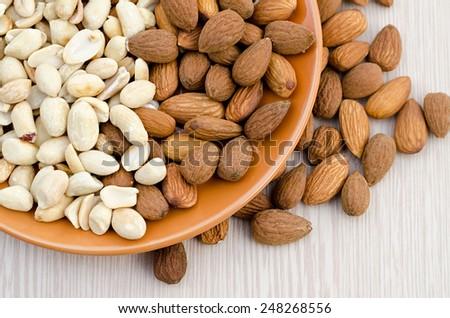 almonds and peanut close up - stock photo