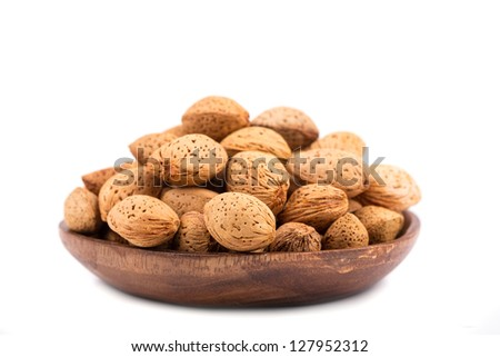 almonds in a bowl on a white background - stock photo