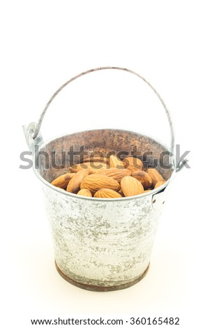 Almonds in bucket isolated on white background, stock photo - stock photo