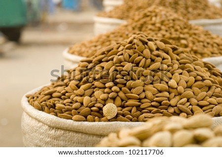 Almonds in sacs at the market - stock photo