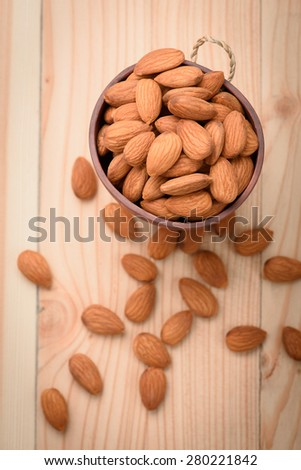 almonds in wood Cup