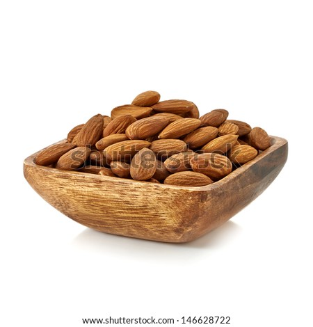 Almonds in wooden bowl on white background - stock photo