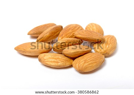 Almonds isolated on white with natural shadow - stock photo