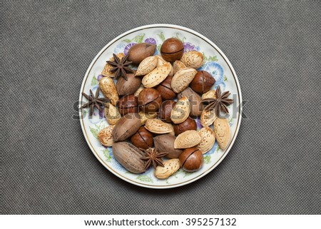 almonds, macadamia nuts, peanuts, cinnamon, anise. Christmas decorations out of food - stock photo