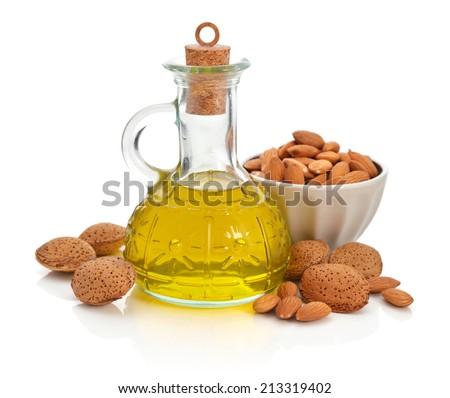 Almonds oil in bottle isolated on white background - stock photo
