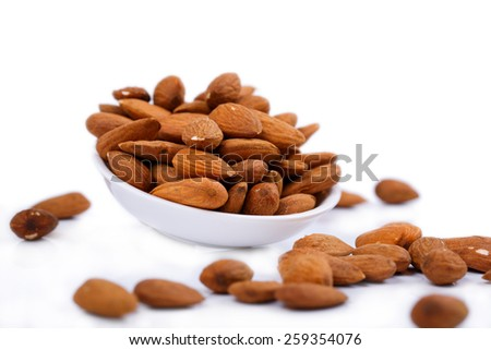almonds on a white plate and white background