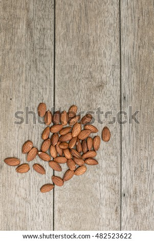 Almonds on a wooden table
