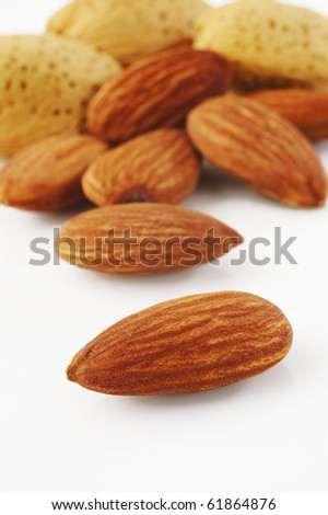 Almonds on white background - stock photo