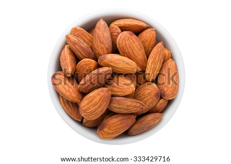 Almonds seed in the bowl isolated on white background. - stock photo