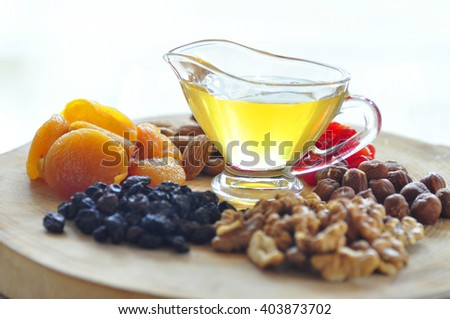 Almonds, walnuts and hazelnuts in wooden bowls - stock photo