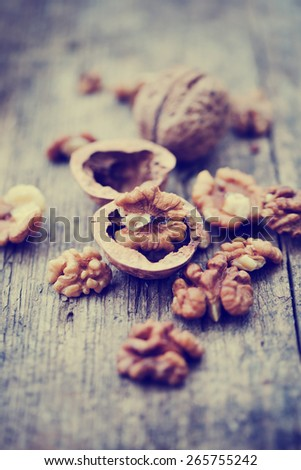 Almonds, walnuts and hazelnuts on wooden table / assortment of nuts - stock photo