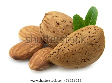 almonds with a leaf - stock photo