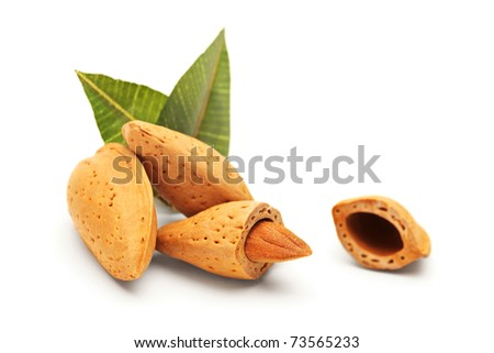 Almonds with green leaves isolated on white background - stock photo