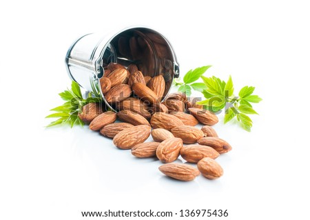 almonds with green leaves, vegetarian food, healthy lifestyle - stock photo