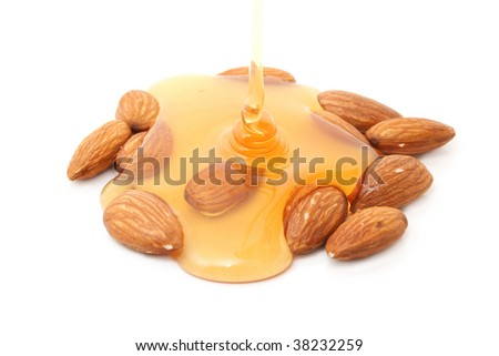 almonds with honey isolated on white - stock photo