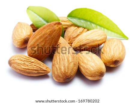 Almonds with leaves isolated on white background - stock photo