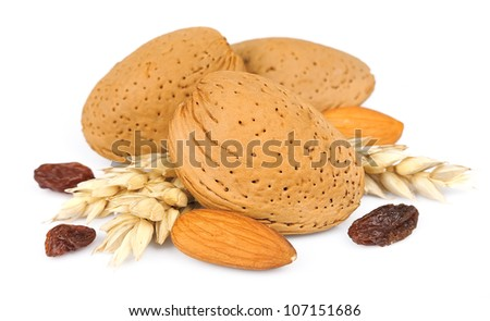 Almonds with raisin and cone wheat on white - stock photo
