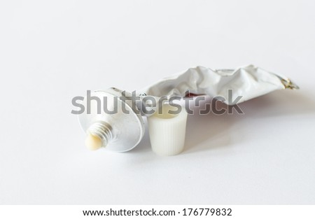 Almost empty of skin medicine tube isolated on white background. - stock photo