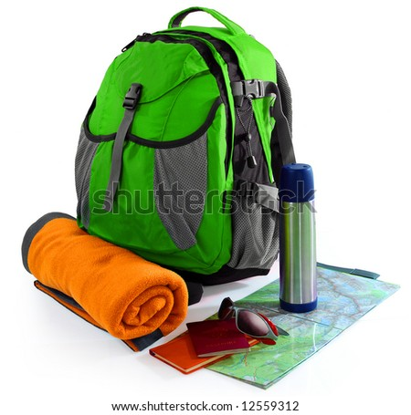 Almost packed backpack - ready for vacation - stock photo