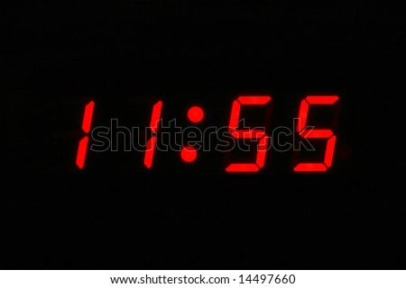 Almost Twelve O'clock - digital clock displaying 11 55 - stock photo
