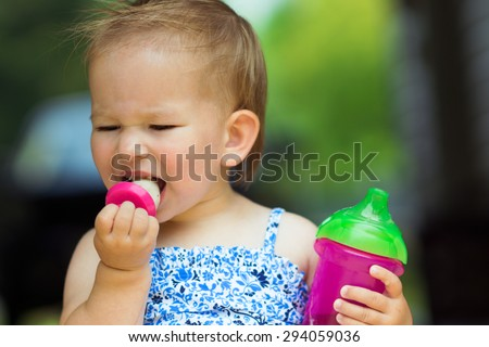 Almost two year old enjoying a homemade frozen treat  - stock photo