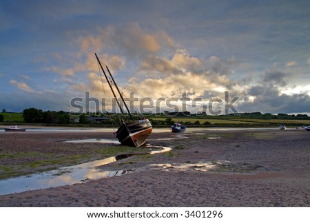 Alnmouth and the  river Aln at low tide during sunset - stock photo